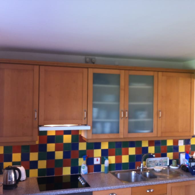 build in cupboards, ceramic wall tiles