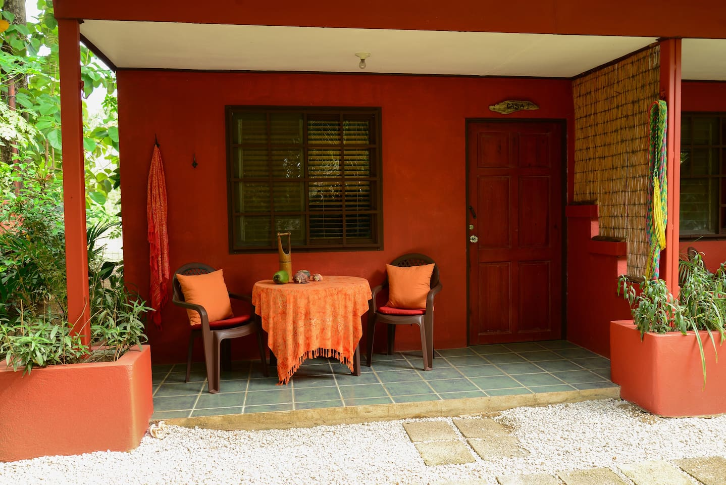 Private Porch of our studio apartment overlooking tropical gardens