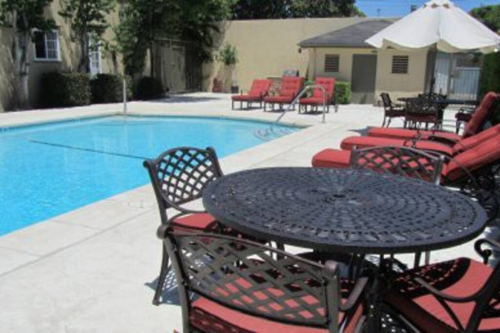 The heated pool with comfy lounge chairs and tables!