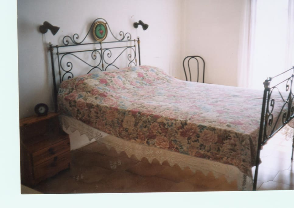 traditional iron-crafted double bed