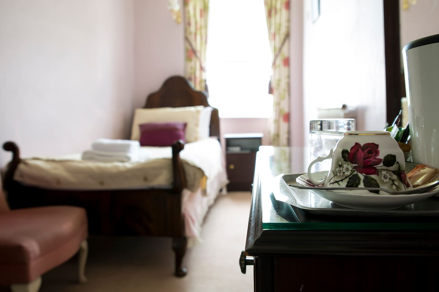 This is Brantfell, one of three single shower -ensuite rooms at our Bed and Breakfast, Blenheim Lodge. As you can see, towels, a hospitality tray and pretty Laura Ashley curtains and colours make this room a homely place to stay.