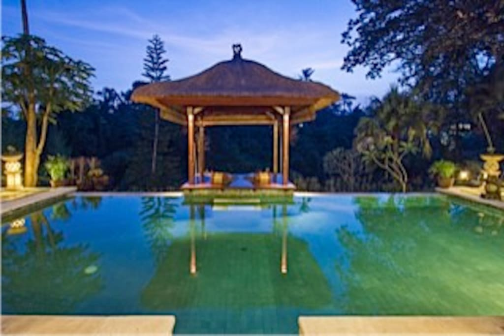 Pool and gazebo at night