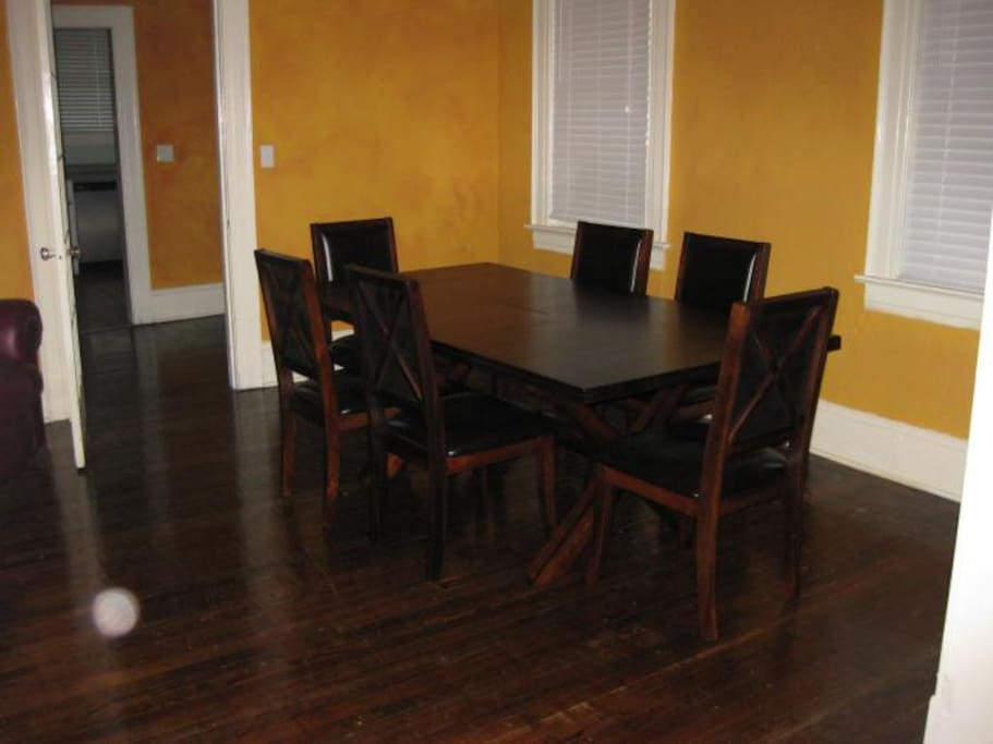 Dining room, seating for 6 plus play area out of shot, walk through arch to living room