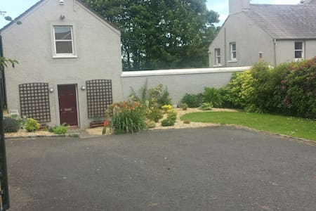 Our 2 bedroom property sleeps 4 people.  It is a separate house in the grounds of our main property, with a shared courtyard and is perfect as a family base from which to visit Northern Ireland.  It has private parking and is fully self catered.