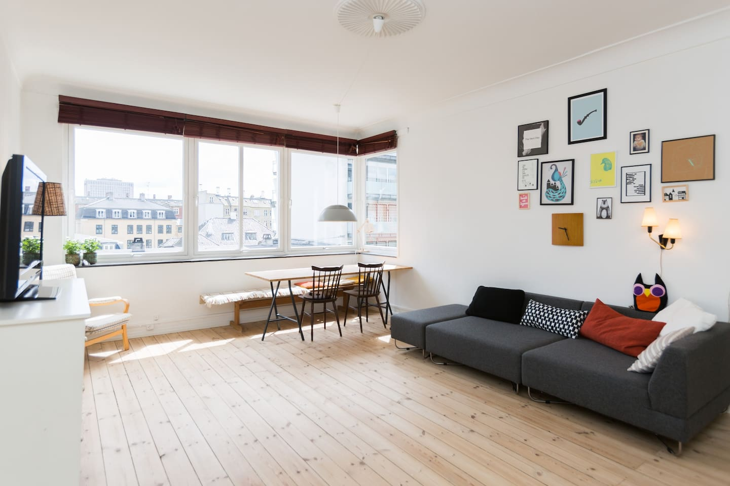 Our large and bright living room with beautiful wooden floors. The large window section allows for a lot of light.