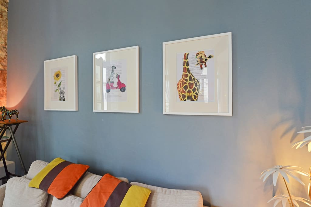 The lounge area with contemporary sofa and artwork