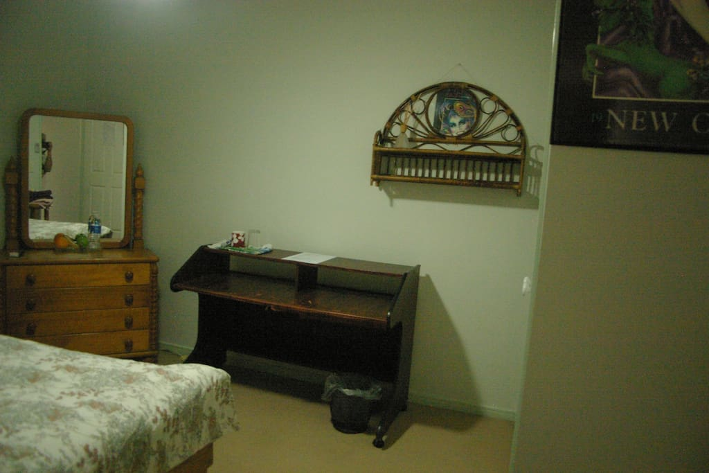 North Bedroom.Built in robes. Desk. Dressing table with mirror and double bed.