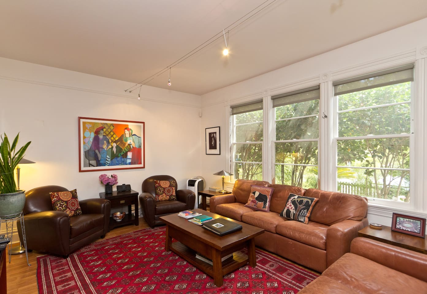 The living room is well lit, spacious and comfortably furnished.