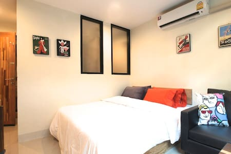 Our cool and comfortable  studio room apartment with has true feeling of real Bangkian . It comfortably fits two people and is central located on a quiet street, just 5 minutes walk from BTS.
