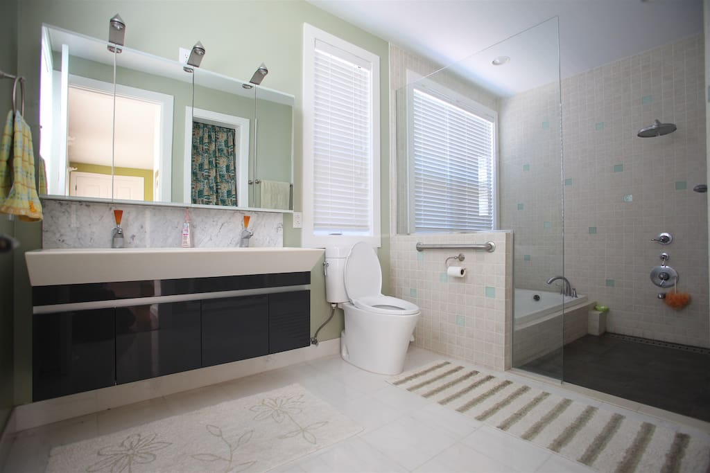 Master Bath 1. Your Private Bathroom with a jacuzzi, two wash basin, spacious and very clean and bright.