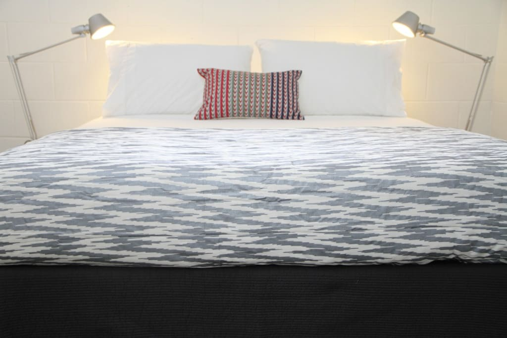 luxury queen size bed with premium linens