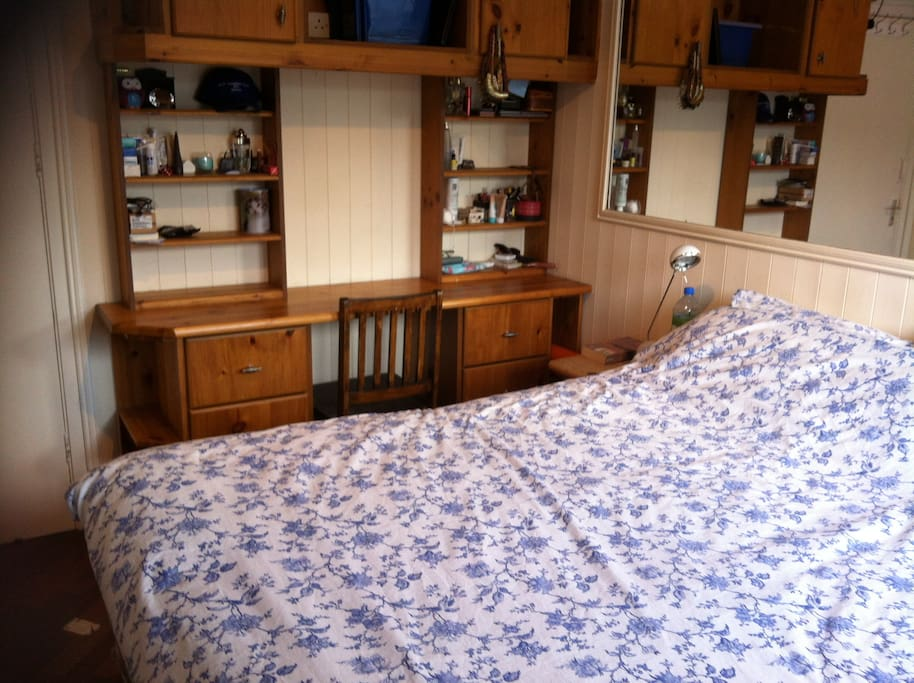 A very comfortable double room with storage, a lock, and lots of light.