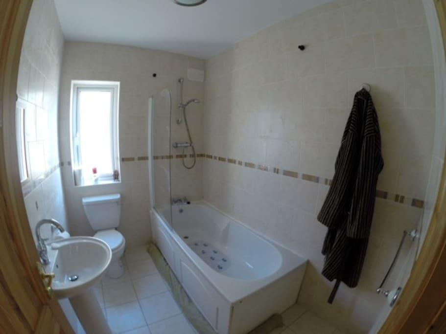Bathroom with large bath.