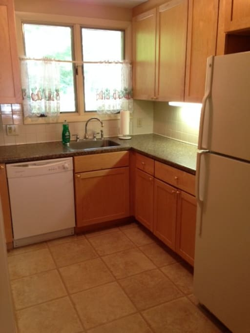 Fully-equipped kitchen with garbage disposal, dishwasher, and microwave