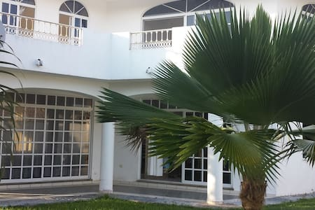 Mita Surf House is a spacious home located just 3 blocks from a picturesque beach known for surfing and swimming.  Each of our 2 guest rooms has a terrace and there is a shared living room and backyard.  Healthy breakfast included!