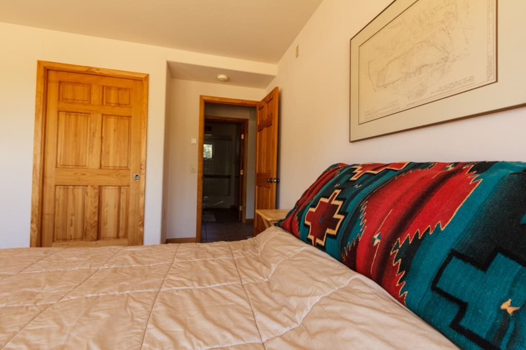 Cozy queen-size bed with full, private bathroom right across the hall