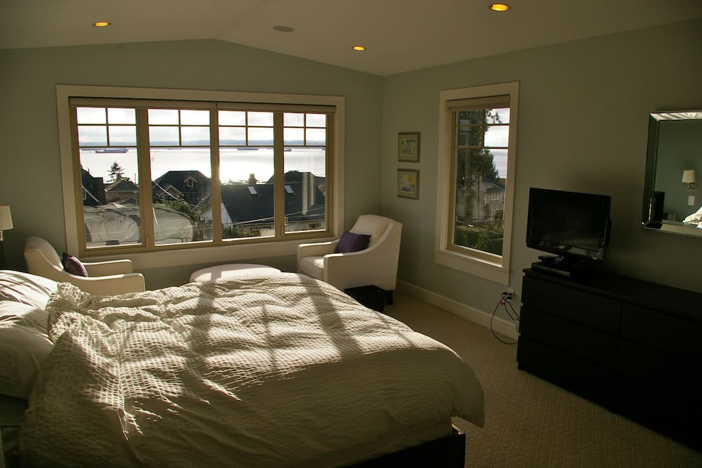 Master bedroom with stunning ocean views and sunsets!