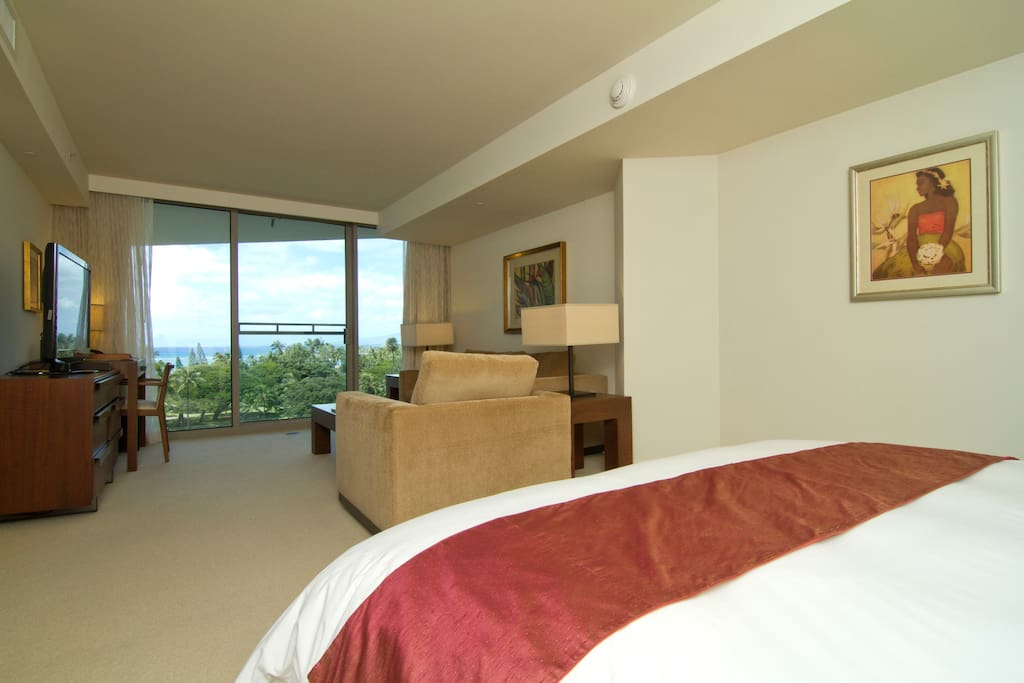 Plush King bed looking out to unobstructed ocean views