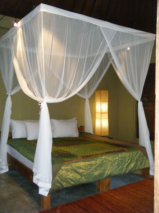 Our King bed for restorative rest....put down the netting and make a cozy hideaway!