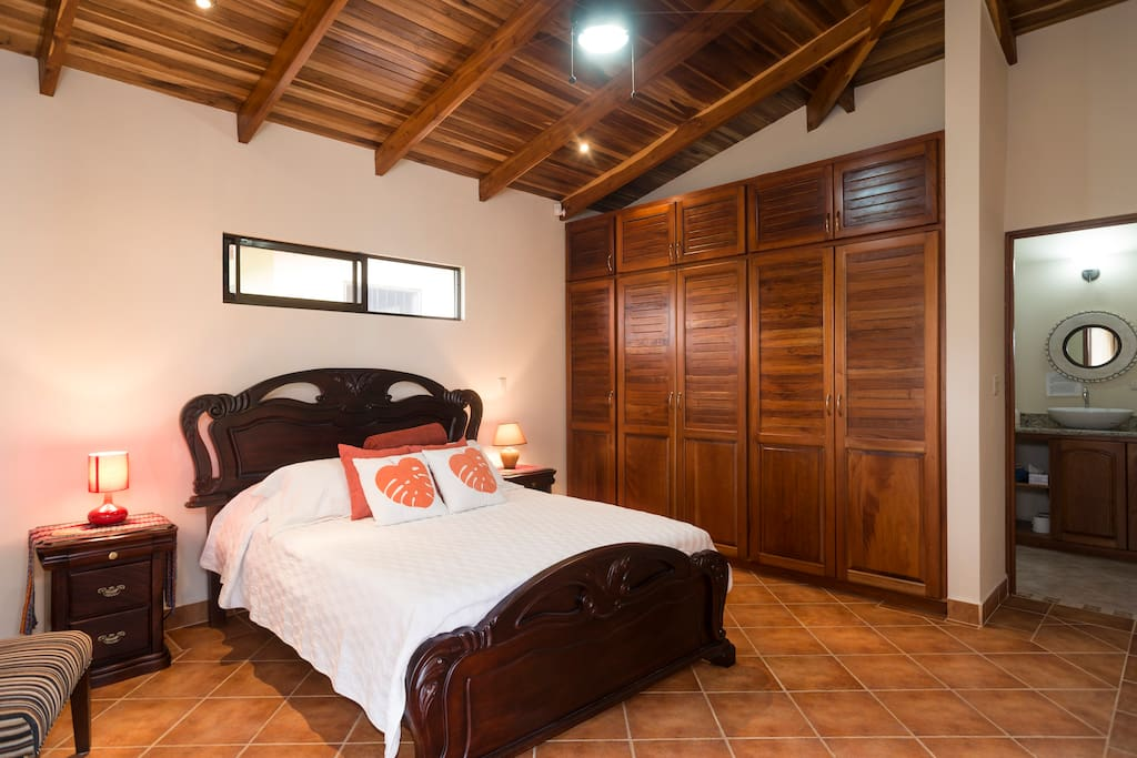 Master bedroom with ceiling and closets of native hardwoods