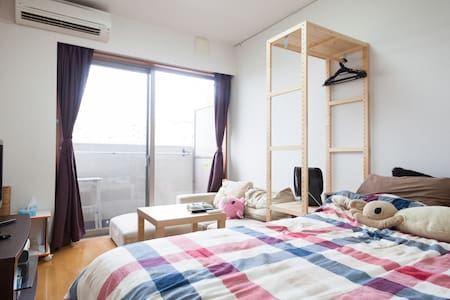 We offer an apartment room on the 3rd floor, corner room and thick walls, a double bed from IKEA. The train station nearest to the apartment can take you to Shibuya in 3mins! You can find nice ramen, sushi, parks, etc. near by.