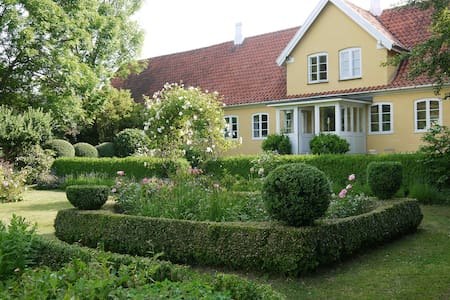 Farmhouse in fairytale garden