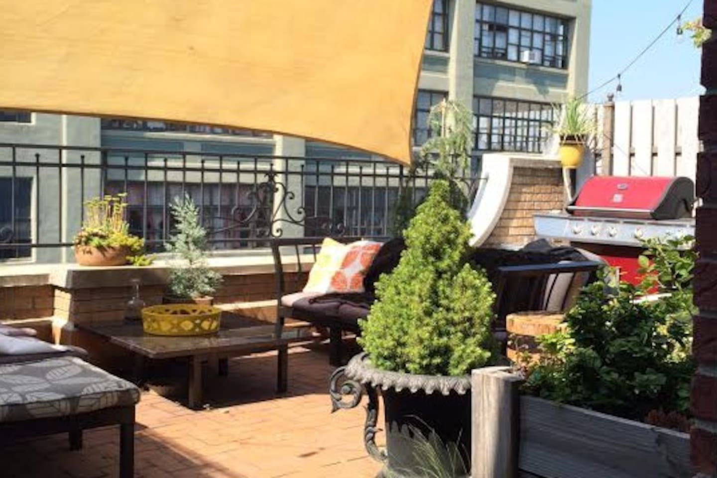 Our private patio with great Manhattan views, and a projector for movies - screen 14 ft wide - seats 10 or more at night