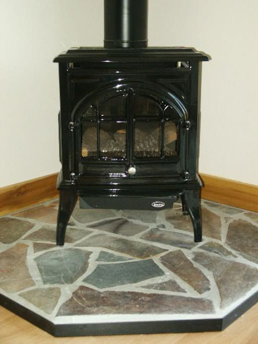 Cast iron stove in the living room is gas burning and thermostat controled for your comfort.