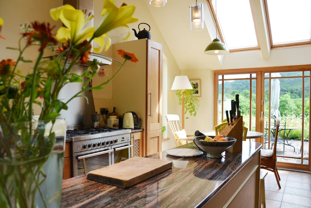 The eco lodge kitchen with view of patio
