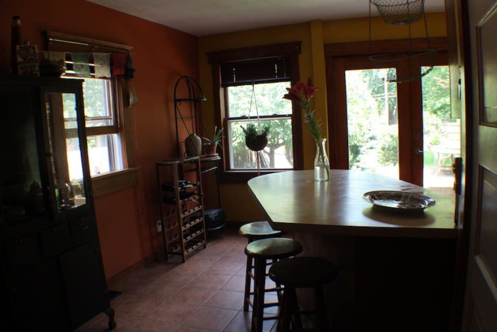 French doors off of kitchen open onto back deck