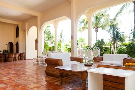 Casa Caribe seaside retreat is set in a hacienda style building, across from white sand beach & a stroll to town. 15 mins to Cancun airport and close to attractions of the region. We have 5 large airy bedrooms. 3 King, 1 x 2 dbl, 1 King w. fold out