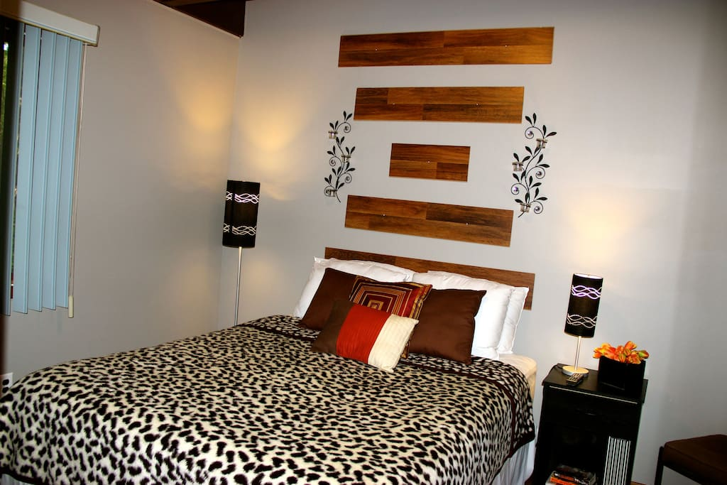 Bedroom with queen size bed and 32' HDTV/DVD