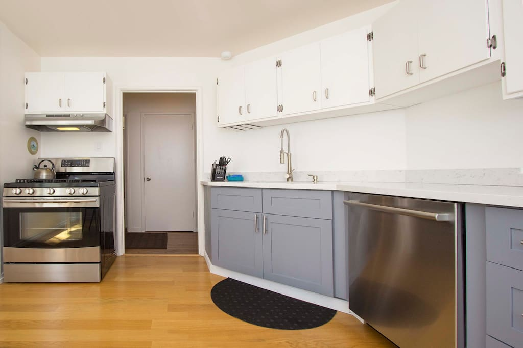 Kitchen is fully stocked with everything you could need including pots/pans, Keurig Pod Coffee machine, water, fresh fruit and a bottle of wine.