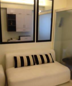 SM light newly furnished Condo - Condominium