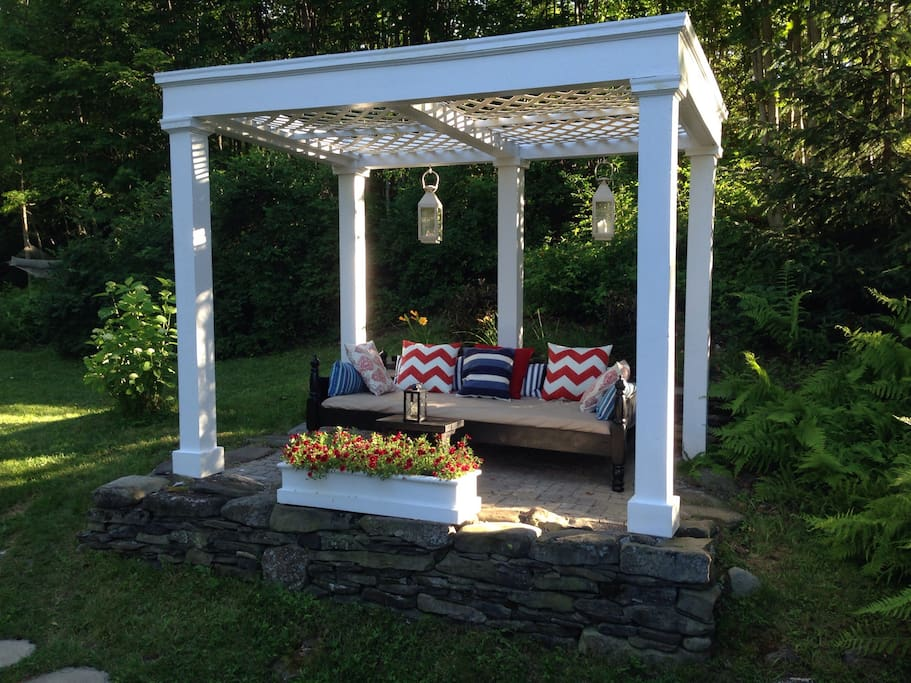The outdoor daybed is a perfect place for morning coffee.