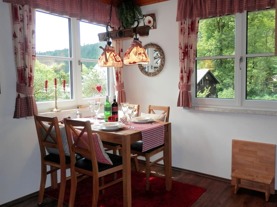 Cosy dining corner featuring dual aspect windows providing panoramic mountain views.