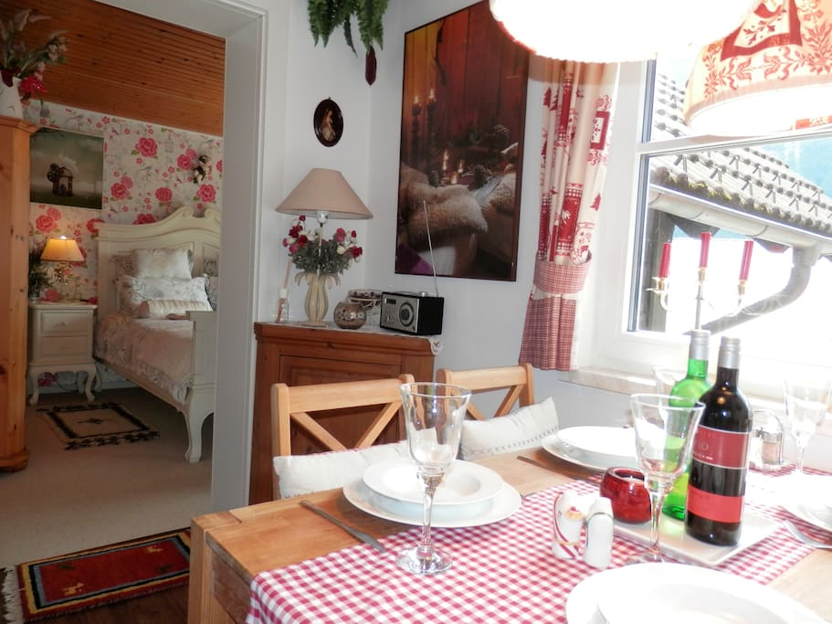 Enjoy a cosy evening in the dining room of Apartment 2. The bedroom features a Satellite TV and DVD.