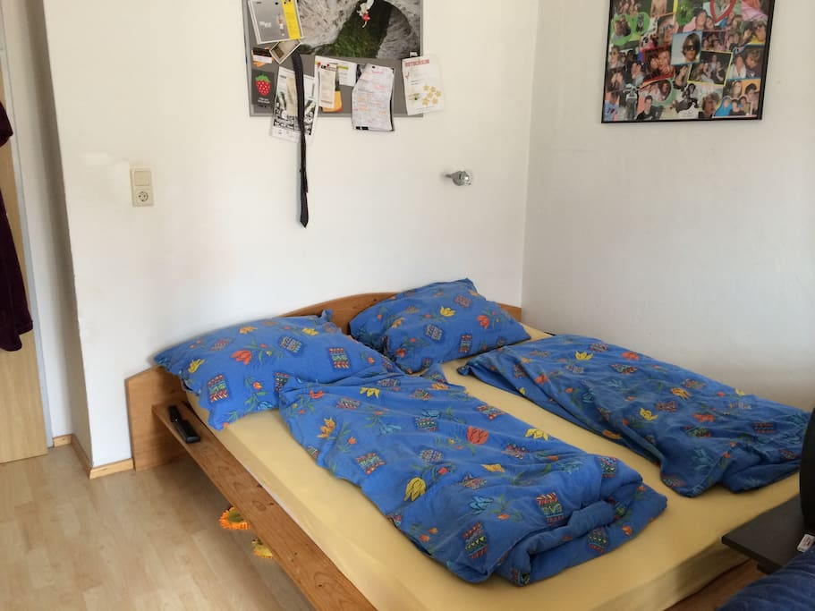 double bedroom with one extra bed