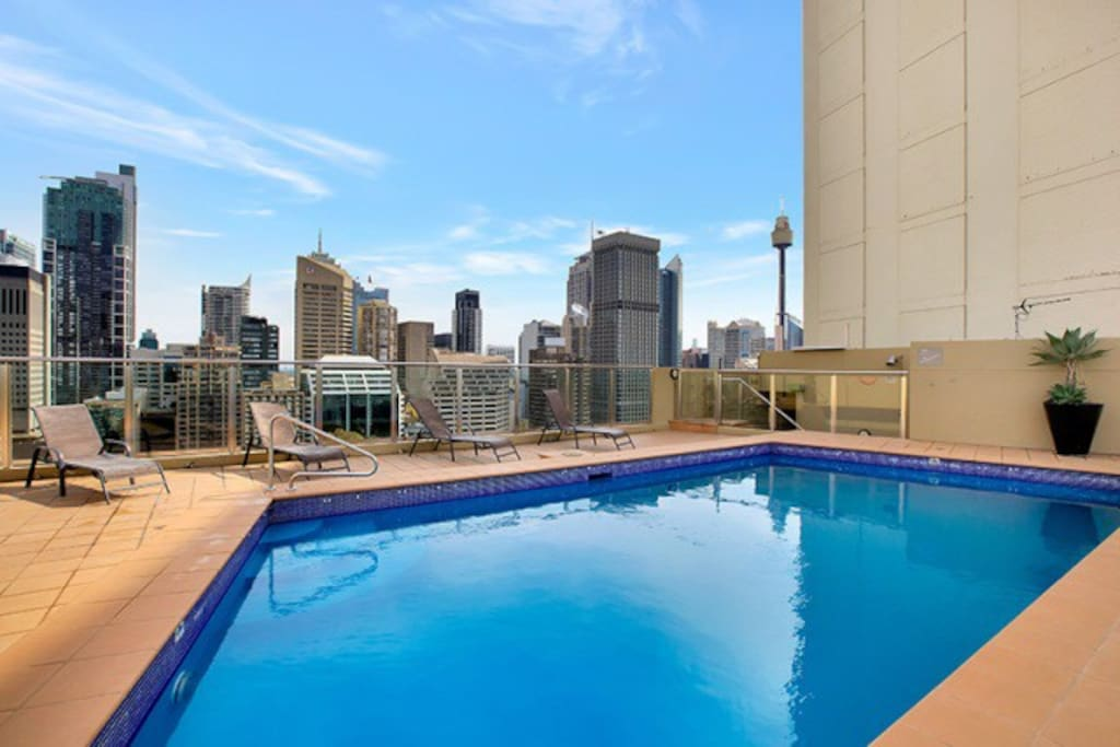 Heated roof top swimming pool with exceptional  harbour and city views.