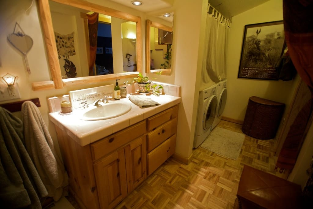 Roomy bath with walk in shower to left of sink.