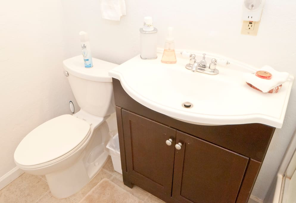 Bathroom has comode, sink, tub/shower combo & comes with basic bathroom supplies.