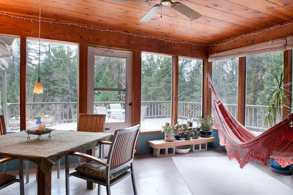 Sliding glass doors leading to the sunroom.