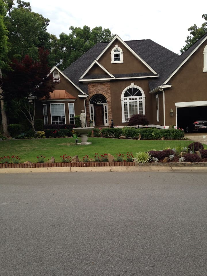 Professionally landscaped yard w beautiful planting a and fountain