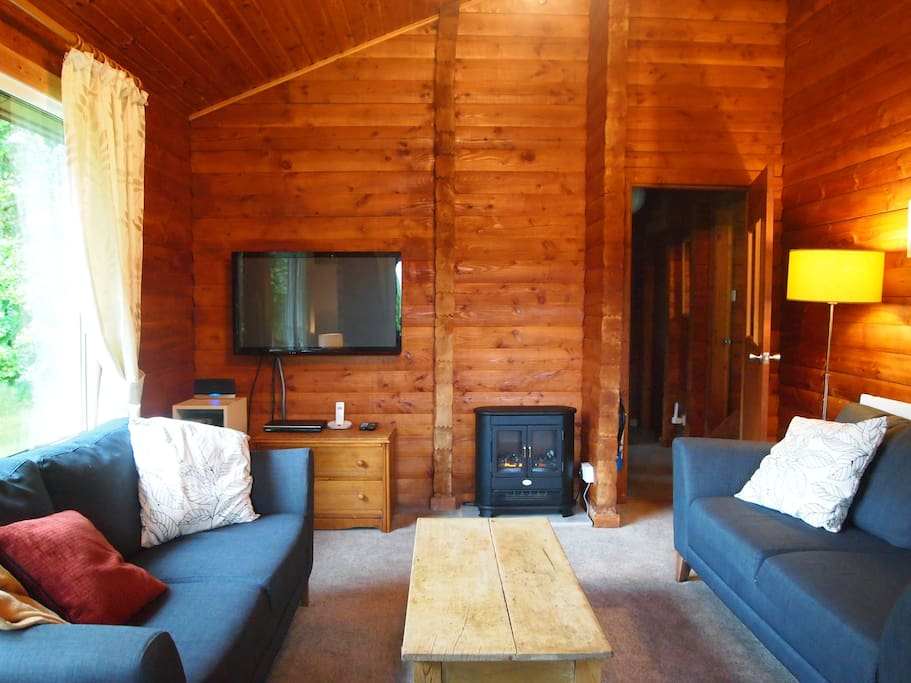 The comfy, cosy living room includes hifi with i-pod dock, library of books, board games & DVDs.
