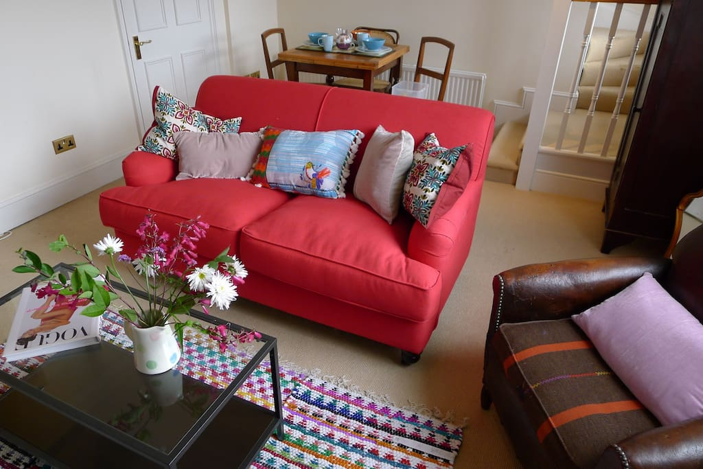 The red sofa beckons!