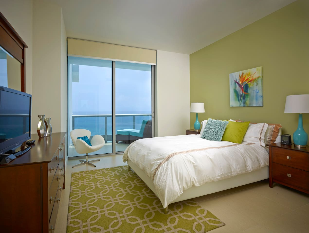 Private bedroom with queen size bed and floor to ceiling windows providing a lot of natural light