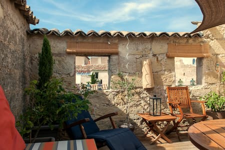 """Porte 22"", our stylish 350 (!) years' old stone house in the center of the beautiful market town of Pézenas. Wooden beams, exposed stone, secluded roof terrace, 5 star kitchen, just steps from the weekly market. Authentic charm with a modern touch."