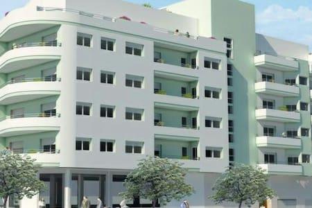 Светлая, новая квартира у моря - Apartamento