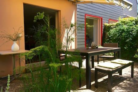 Villa avec jardin proche du centre d'Yverdon - Talo