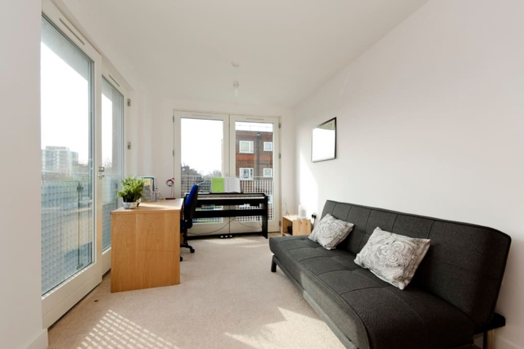 Your room, sofa turns into a comfortable double bed, and there are now blinds up!